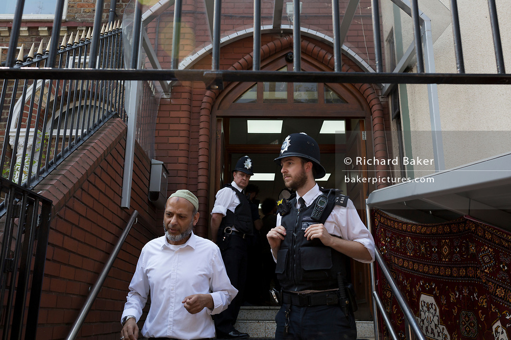 Following the attack on a group of Muslim men outside the Finsbury Park mosque which killed one person and seriously injured another ten, Met Police officers guard the entrance of the Islamic building, on 19th June 2017, in the borough of Islington, north London, England.