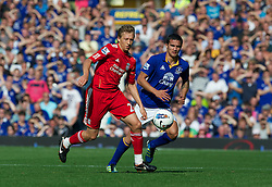 LIVERPOOL, ENGLAND - Saturday, October 1, 2011: Liverpool's Lucas Leiva in action against Everton's Tim Cahill during the Premiership match at Goodison Park. (Pic by David Rawcliffe/Propaganda)