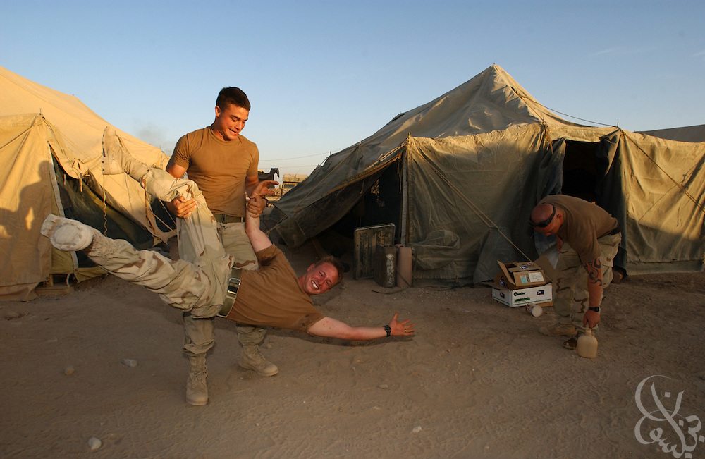 U.S. Army Sgt. Richard Hess (L) from Springfield, TN swings Pfc. Alan Lott during an impromptu wrestling match May 10, 2002 at Kandahar airfield in Afghanistan. Hess and Lott are members of the 2nd Battalion, 187 regiment that has been deployed in Afghanistan since early January as part of Operation Enduring Freedom.