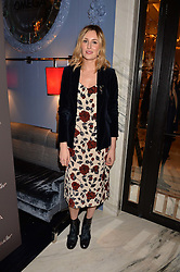 LONDON, ENGLAND 8 DECEMBER 2016: Laura Carmichael at the Omega Constellation Globemaster Dinner at Marcus, The Berkeley Hotel, Wilton Place, London England. 8 December 2016.