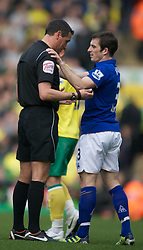 NORWICH, ENGLAND - Saturday, April 7, 2012: Everton's Nikica Jelavic  shows his disappontment as his brace was not enough to give Everton all the three points  in  the Premiership match at Carrow Road. (Pic by Marcello Pozzetti/Propaganda)NORWICH, ENGLAND - Saturday, April 7, 2012: Everton's Leighton Baines gets too friendly with Ref: paul Marriner in  the Premiership match at Carrow Road. (Pic by Marcello Pozzetti/Propaganda)