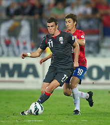 NOVI SAD, SERBIA - Tuesday, September 11, 2012: Wales' Gareth Bale in action against Serbia's Filip Duricic during the 2014 FIFA World Cup Brazil Qualifying Group A match at the Karadorde Stadium. (Pic by David Rawcliffe/Propaganda)