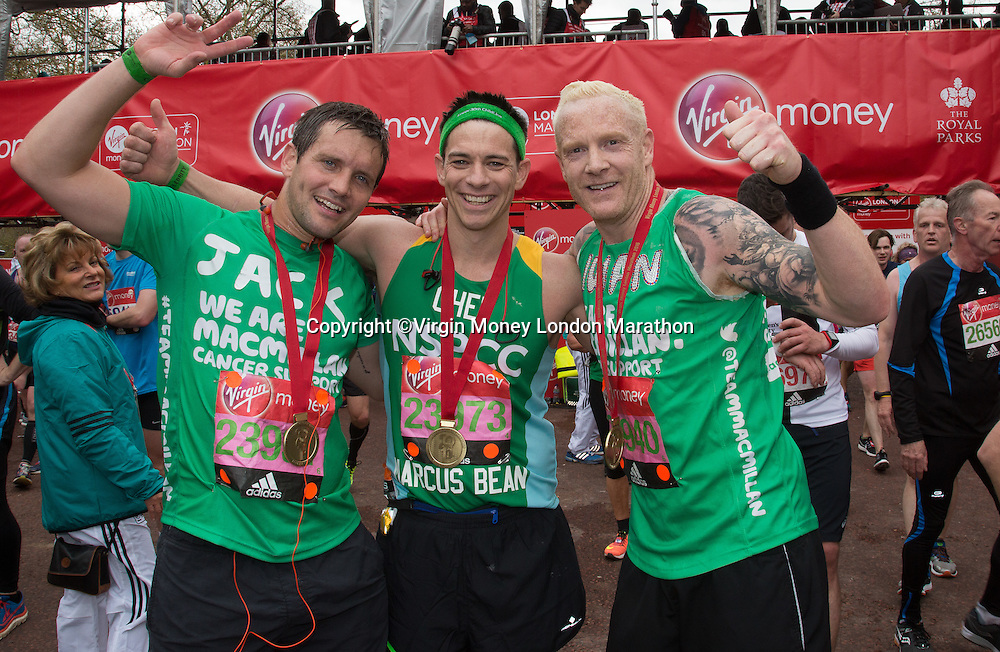 Jack Ashton (Call The Midwife actor, running for Macmillan), left, Marcus Bean (TV Chef, running for NSPCC), centre, and Iwan Thomas MBE (former 400m athletics world champion and TV presenter, running for Macmillan) celebrate after finishing The Virgin Money London Marathon, Sunday 24th April 2016<br /> <br /> Photo: Roger Allen for Virgin Money London Marathon<br /> <br /> For more information please contact media@londonmarathonevents.co.uk