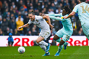 Queens Park Rangers midfielder Eberechi Eze (10) fouls Leeds United defender Luke Ayling (2) during the EFL Sky Bet Championship match between Leeds United and Queens Park Rangers at Elland Road, Leeds, England on 2 November 2019.