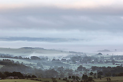 © Licensed to London News Pictures. 03/07/2015. Malham, UK. Picture shows fog over the Village of Malham in the Yorkshire Dales. Hailstones the size of golf balls and fierce lightning storms battered homes yesterday but blue skies are set to return today . Temperatures are set to soar to 29C (82F) today. Photo credit : Andrew McCaren/LNP