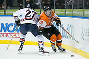 RIT forward Myles Powell gets past Robert Morris forward Zac Lynch behind the Robert Morris net during the Atlantic Hockey final at the Blue Cross Arena in Rochester on Saturday, March 19, 2016.