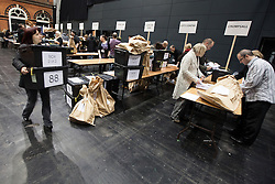 © Licensed to London News Pictures . 15/11/2012 . Manchester , UK . Ballot boxes being unloaded at the count . By elections in Manchester Central and Ardwick and Greater Manchester Police and Crime Commissioner ( PCC ) Election counts at Manchester Central Convention Centre . Photo credit : Joel Goodman/LNP
