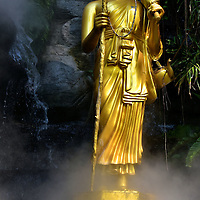 Gilded Buddha Standing at Wat Saket in Bangkok, Thailand <br />