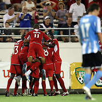 Orlando City players celebrate a goal during a United Soccer League Pro soccer match between the Wilmington Hammerheads and the Orlando City Lions at the Florida Citrus Bowl on June 18, 2011 in Orlando, Florida.  (AP Photo/Alex Menendez)