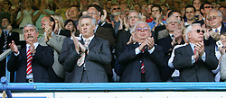 Portsmouth, England: Saturday, April 28, 2007: Liverpool Directors, L-R Chairman David Moores, Chief-Executive Rick Parry, Terry Smith and co-owner George Gillette, take part in the minutes applause after the death of Alan Ball before the Premiership match against Portsmouth at Fratton Park (Pic by Chris Ratcliffe/Propaganda)