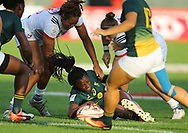 DUBAI, UNITED ARAB EMIRATES - Thursdays 30 November 2017, Veroeshka Grain of South Africa is tackled during HSBC Emirates Airline Dubai Rugby Sevens match between South Africa and the USA at The Sevens Stadium in Dubai.<br /> Photo by Roger Sedres/ImageSA