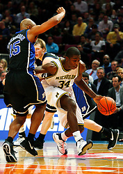 Nov 21, 2008; New York, NY, USA; Michigan Wolverines forward DeShawn Sims (34) dribbles past Duke Blue Devils forward Gerald Henderson (15) during the 2K Sports Classic Championship game at Madison Square Garden. Duke won 71-56.