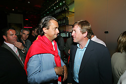 LIVERPOOL, ENGLAND - WEDNESDAY, JUNE 9th, 2005: Tennis Legend Henri Leconte shakes hands with Liverpool FC Legend Kenny Dalglish after winning the auction for his shirt during the Players Party at the St Thomas Hotel during the 4th Liverbird Developments Liverpool International Tennis Tournament. (Pic by Dave Rawcliffe/Propaganda)