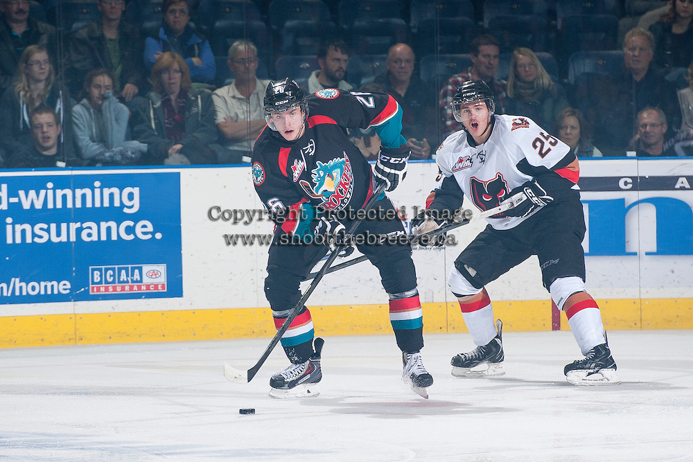 KELOWNA, CANADA - OCTOBER 22: Cole Linaker #26 of the Kelowna Rockets is checked by Greg Chase #25 of the Calgary Hitmen on October 22, 2013 at Prospera Place in Kelowna, British Columbia, Canada.   (Photo by Marissa Baecker/Shoot the Breeze)  ***  Local Caption  ***
