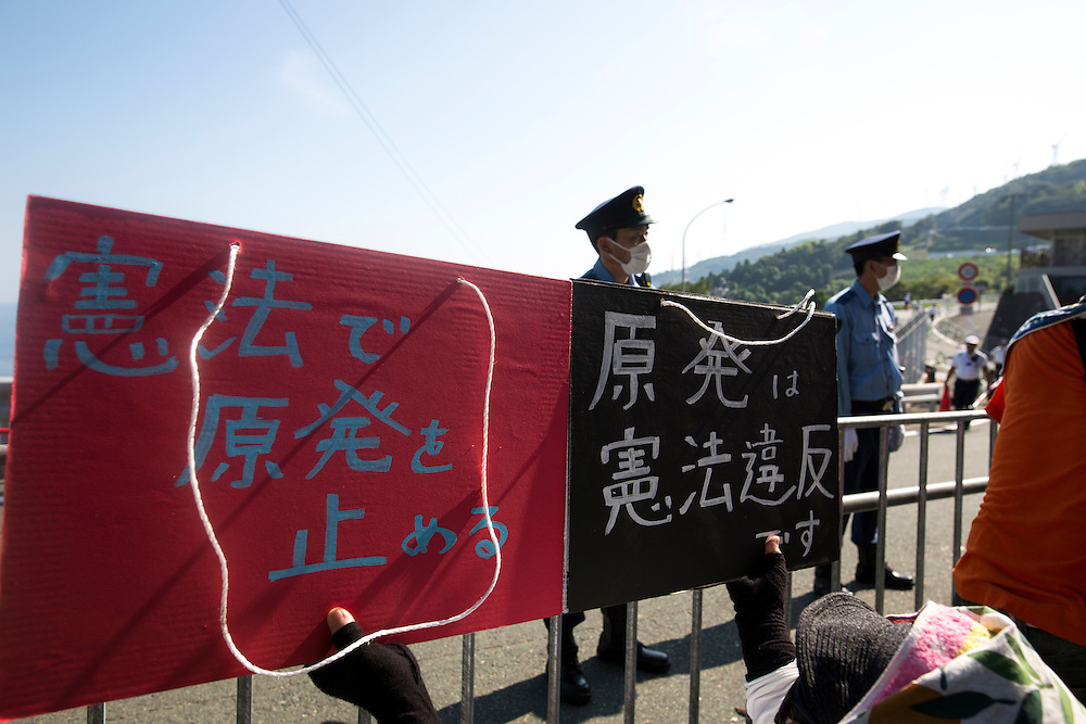 EHIME, JAPAN - AUGUST 12 : Anti-nuclear protesters with placards gather in front of Ikata Nuclear Power Plant to protest against the restarting of a nuclear reactor on August 12, 2016 in Ikata, Ehime prefecture, northwestern Shikoku, Japan. The Shikoku Electric Power Company restarted the plant's No.3 reactor at around 9 AM on Friday. It is the third plant to go online under new regulations issued after the Fukushima Daiichi nuclear disaster. (Photo by Richard Atrero de Guzman/NURPhoto)