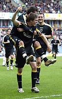 Photo: Paul Greenwood/Richard Lane Photography. <br />Burnley v Cardiff City. Coca-Cola Championship. 26/04/2008. <br />Goalscorer Aaron Ramsey gives a piggyback to the other Cardiff goal scorer Joe Ledley
