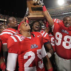 22 November 2008: Ole Miss players celebrate with the Magnolia Trophy following the Ole Miss Rebels 31-13 victory over the LSU Tigers at Tiger Stadium in Baton Rouge, LA.