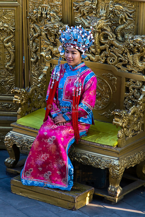 Young girls dress up in decorative traditional clothing in Jingshan Park, Beijing.