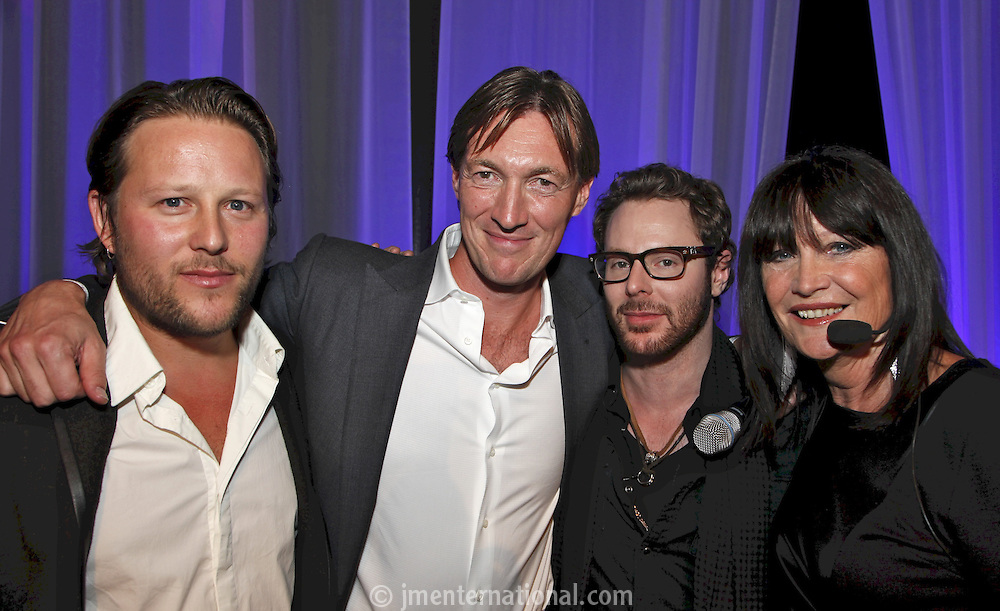 L to R - Adam Tudhope (Everybody's management winners of The Achievement Award) Brian Message (MMF Chairman), award presenter Sean Parker (Napster co-creator and founding president of Facebook) and host Sandie Shaw. The Artist and Manager Awards 2011, The Roundhouse, London..Tuesday, Sep.13, 2011