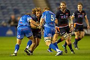 Pierre Schoeman (#1) of Edinburgh Rugby runs at Brok Harris (#1) and Matthew Screech (#5) of Dragons Rugby during the Guinness Pro 14 2018_19 match between Edinburgh Rugby and Dragons Rugby at BT Murrayfield Stadium, Edinburgh, Scotland on 15 February 2019.