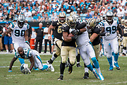 Thomas Davis(58) rides down Mark Ingram(22) in the New Orleans Saints 34 to 13 victory over the Carolina Panthers.