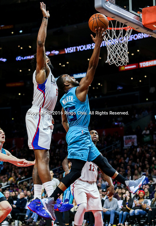 Charlotte Hornets Kemba Walker goes up for a lay up against Los Angeles Clippers DeAndre Jorda during the NBA basketball game in Los Angeles, the United States, Jan. 9, 2016. Los Angeles Clippers won 97-83. (Xinhua/Zhao Hanrong)(Photo by Ringo Chiu/PHOTOFORMULA.com)<br /> <br /> Usage Notes: This content is intended for editorial use only. For other uses, additional clearances may be required.
