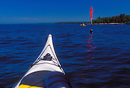 Sea kayaks and a commercial fishing net marker near York Island in Apostle Islands National Lakeshore near Bayfield, Wis.