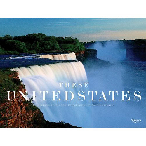 These United States, Signed by Jake Rajs, Introduction by Walter Cronkite, Published by Rizzoli, Midsize Dimensions: 14.4 x 1.1 x 10.8 inches<br /> Hailed by Entertainment Weekly as &quot;the next best thing to a road trip,&quot; These United States is a celebration of the magnificence of the United States of America and a tribute to all that makes it great. Inspired by the deluxe limited edition, Rizzoli is proud to present These United States in a slightly smaller format. It showcases breathtaking panoramic photos from the East to the West Coasts; from the wilderness of the frontier to the cities; and from the earliest American historical landmarks to images of America post-9/11. These United States grandly exhibits the diverse elements comprising the heart and soul of America.<br /> <br /> The photographer of two previous Rizzoli titles who has been published in Life, Esquire, National Geographic and many other magazines, Rajs here delivers a huge, 16&quot; x 12&quot; book that features 220 full-color photos, many of which are full-bleeds, and 10 of which are gatefolds. Aerial shots, pastorals, cityscapes-they're all here. As Cronkite notes, &quot;Jake has woven a stunning tapestry of the many threads of America.&quot; (Oct. 15) Copyright 2003 Reed Business Information. <br /> <br /> Publishers Weekly