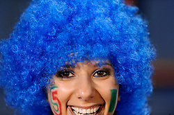 A female Italy fan with a blue wig..