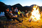 BMW Mottorad North America VP Pieter de Waal (left) sits around with campfire with other riders.