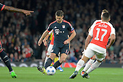 Bayern Munich midfielder Xabi Alonso plays the ball during the Champions League  Group F match between Arsenal and Bayern Munich at the Emirates Stadium, London, England on 20 October 2015. Photo by Alan Franklin.