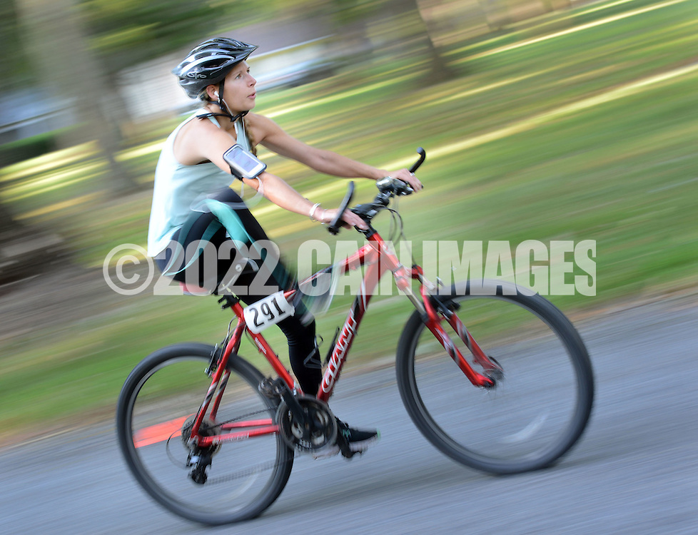 EDITORS NOTE: RACE ACTUALLY STARTED AT 7AM AND NOT 8AM AS ON ASSIGNMENT: Jesse Swanson hops off her bike in transition while competing in the Bucks County Duathlon Sunday September 4, 2016 at Washington Crossing Park in Washington Crossing, Pennsylvania. (Photo by William Thomas Cain)