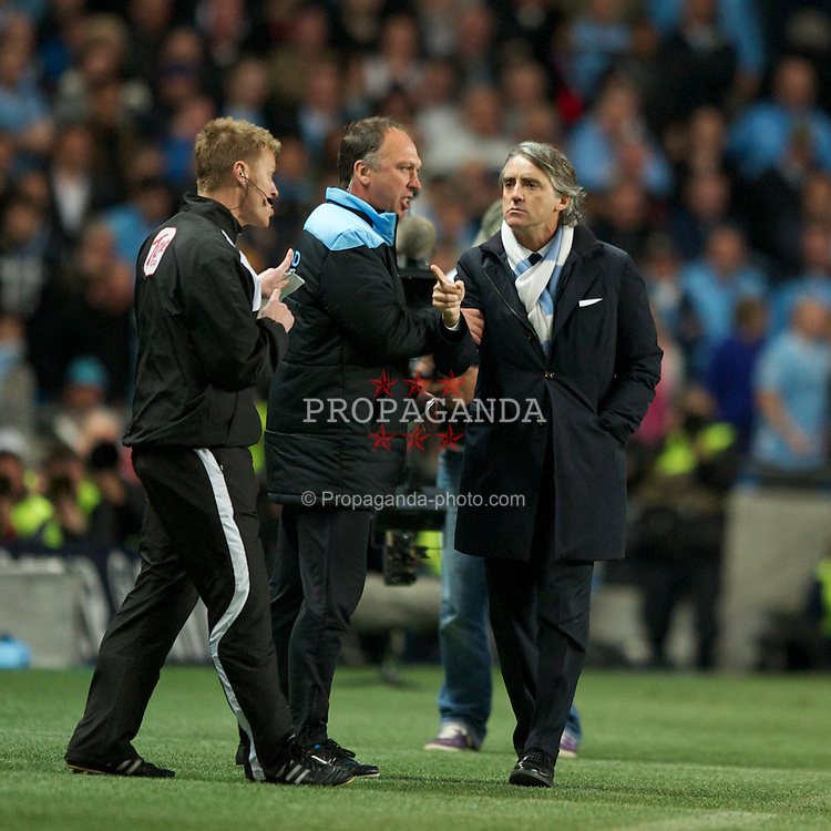 MANCHESTER, ENGLAND - Monday, April 30, 2012: Manchester City manager Roberto Mancini complains to the fourth official after clashing with Manchester United manager Sir Alex Ferguson during the Premiership match at the City of Manchester Stadium. (Pic by Chris Brunskill/Propaganda)