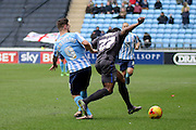 Coventry City Striker Adam Armstrongtussles with Bury Defender Nathan Cameron during the Sky Bet League 1 match between Coventry City and Bury at the Ricoh Arena, Coventry, England on 13 February 2016. Photo by Chris Wynne.