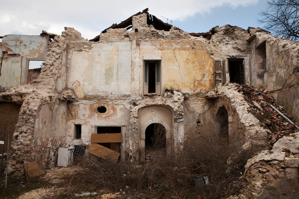 An abandoned  building damaged by the earthquake in the historical center city. On 6 April 2009 a strong earthquake hit the city of L'Aquila, in the central Abruzzo region of Italy, leaving 308 dead and tens of thousand homeless. 4  years after In the historical center of the city few signs of reconstructions could be seen. On the other hand the effects of the of abandonment add up to the destruction of the quake. .