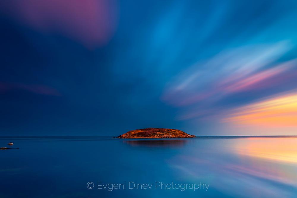 Small island in a calm sea