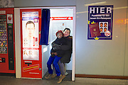 Vienna, Austria. David and Raz S. at a passport photo machine.<br /> David S. and his adopted son Raz S. have been stuck in Vienna for months, because the German authorities confiscated Raz' passport, suddenly assuming his adoption in 2003 was not legal.