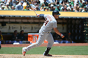 May 29, 2014; Oakland, CA, USA; Detroit Tigers first baseman Miguel Cabrera (24) grounds out scoring second baseman Ian Kinsler (3, not pictured) against the Oakland Athletics during the third inning at O.co Coliseum.