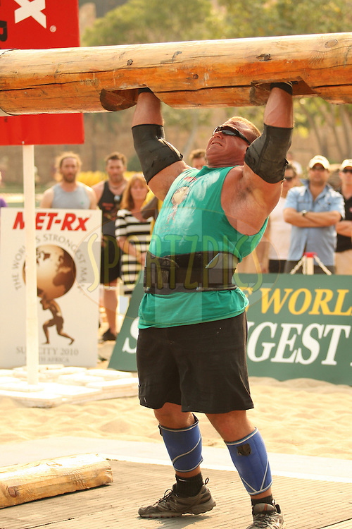 Derek Poundstone (USA) finds the going tough in the overhead log-lift during the final rounds of the World's Strongest Man competition held in Sun City, South Africa.