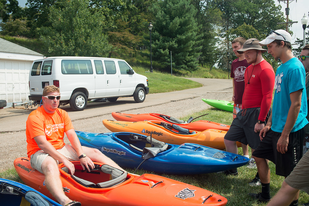 Nick Farline goes over some of the basics before his Fundementals of Kayaking class hits the water, at Strouds Run.