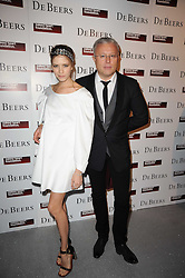 ALEXANDER LEBEDEV and ELENA PERIMNOVA at The Love Ball hosted by Natalia Vodianova and Lucy Yeomans to raise funds for The Naked Heart Foundation held at The Round House, Chalk Farm, London on 23rd February 2010.