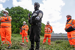 © Licensed to London News Pictures. 12/05/2020. Colne Valley, UK. Bailiffs start the eviction of environmental activists from Extinction Rebellion at the HS2 site in Colne Valley, Buckinghamshire. Activists have chained themselves to the floor in an attempt to prevent the eviction. Photo credit: Marcin Nowak/LNP