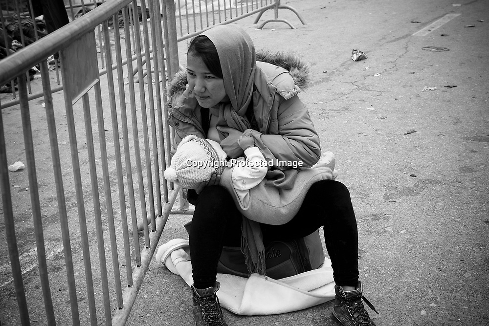 Immigrant and or refugee woman breastfeeding her child in Presevo, Serbia. They just arrived from Macedonia and she's taking the time to feed her baby.