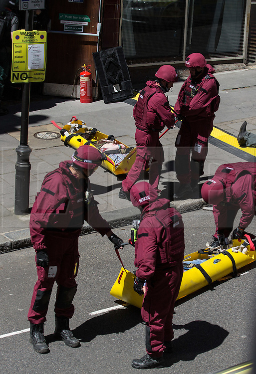 © Licensed to London News Pictures. 30/06/2015. London, UK. A joint exercise called 'Exercise Strong Tower' between the three emergency services and several other security services took place at the disused Aldwych London Underground station. Several actors and dummies portraying dead and injured civilians and service personnel were seen on Surrey Street near the Strand. Photo credit : James Gourley/LNP