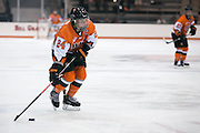 RIT Senior Captain Celeste Brown brings the puck into the offensive zone during an exhibition game against Pursuit of Excellence, a junior team from British Columbia, at RIT's Gene Polisseni Center on Monday, September 29, 2014.
