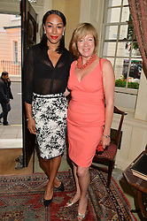 Left to right, JADE JOHNSON and FIONA SANDERSON at The House of Britannia reception hosted by Lady Delves Broughton at 42 Berkeley Square, London on 26th June 2014.