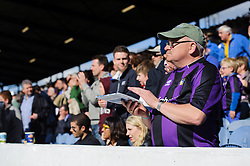 A Bristol Rovers fan claps as the teams come out for the second half - Photo mandatory by-line: Rogan Thomson/JMP - 07966 386802 - 19/04/2014 - SPORT - FOOTBALL - Fratton Park, Portsmouth - Portsmouth FC v Bristol Rovers - Sky Bet Football League 2.