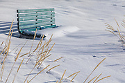 a bench covered with snow