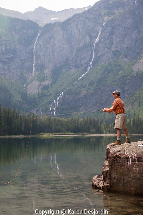A man fly fishing for trout at Avalanche Lake in Glacier National Park, Montana. http://www.gettyimages.com/detail/photo/mature-man-fly-fishing-glacier-national-park-mt-royalty-free-image/181933770