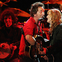 (PPAGE1) Asbury Park 4/20/2006  Bruce Springsteen and wife Patti Scialfa rock the crowd gathered in Convention Hall in preparation of an upcoming tour.  Michael J. Treola Staff Photographer.....>MJT